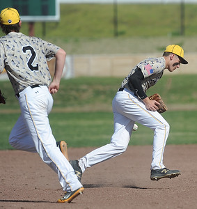 Diamond's Carter Prewitt gets handcuffed by a hot grounder as teammate Trey Bowman backs up the play during their game against Quapaw in the 17th Annual Mickey Mantle Classic on Thursday at Joe Becker Stadium. Globe   Laurie Sisk