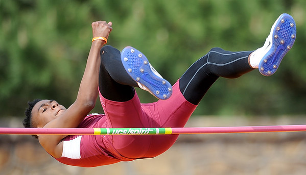 Joplin high jumper xx xx works to clear the bar during the high jump event at the Gorilla Relays on Friday at Pittsburg State's Carnie Smith Stadium.<br /> Globe | Laurie Sisk