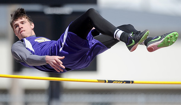 Sarcoxie's Lath Kisling clears the bar and takes first palce in the high jump during Sarcoxie High School's first home meet in 21 years on Saturday at SHS.<br /> Globe | Laurie Sisk