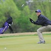 Globe/Roger Nomer<br /> Blake Poage, Monett junior, watches his putt go wide during Monday's golf tournament in Carthage.