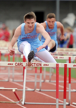 Webb City's Nathan Deadmond races to a first place finish in the hurdles on Friday at CJHS.<br /> Globe | Laurie Sisk