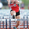 Carl Junction's Lexi Miller races to a first place finish in her heat of the hurdles on Friday at JHS.<br /> Globe | Laurie Sisk