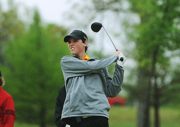 Globe/Roger Nomer<br /> Bryce Sprague, Diamond sophomore, tees off during Monday's golf tournament in Carthage.
