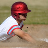Webb City pinch runner Jonas White slides safely into third base on a passed ball during the Cardinals' game against Ozark on Thursday at Webb City.<br /> Globe | Laurie Sisk