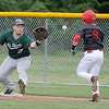 Carl Junction's Ben Luton tries to leg out a bunt attempt as Mount Vernon's Chris Marsh fields the throw at first base during their game on Tuesday at CJHS.<br /> Globe | Laurie Sisk