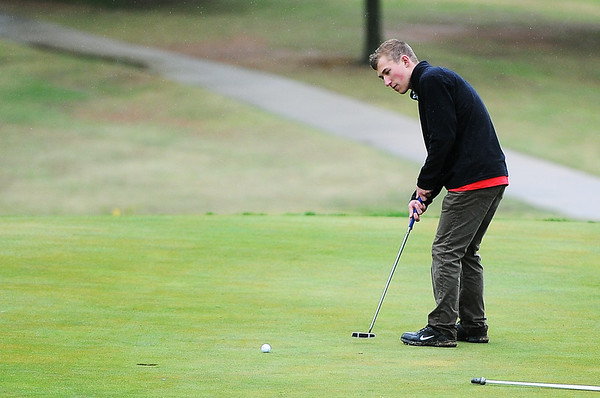 Globe/Roger Nomer<br /> Mathan Knadle, McDonald County senior, putts during Monday's golf tournament in Carthage.