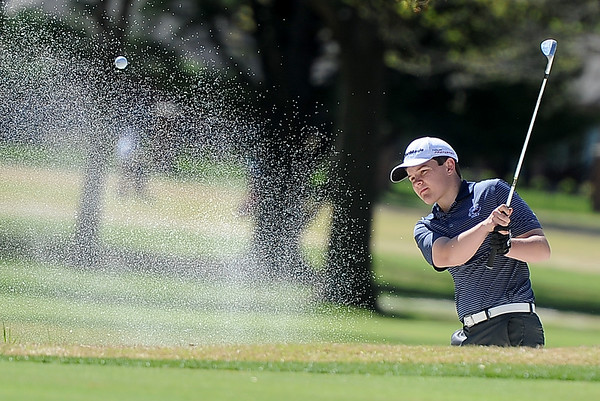 Joplin golfer William Henness hits a chip shot out of the no. 16 bunker during the Joplin Invitational on Thursday at Twin Hills.<br /> Globe | Laurie Sisk
