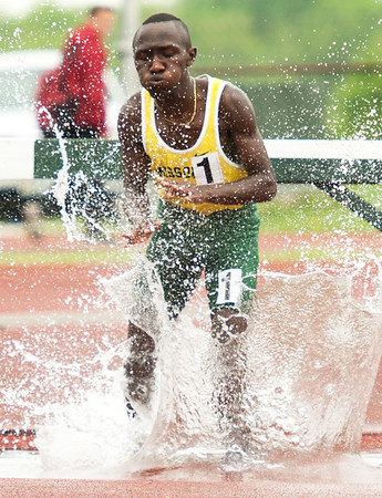 Missouri Southern's Nickson Kiptoo hits the water enroute to first place in the mens steeplechase during the Bill Williams/Bob Laptad Invitational on Friday at MSSU.<br /> Globe | Laurie Sisk