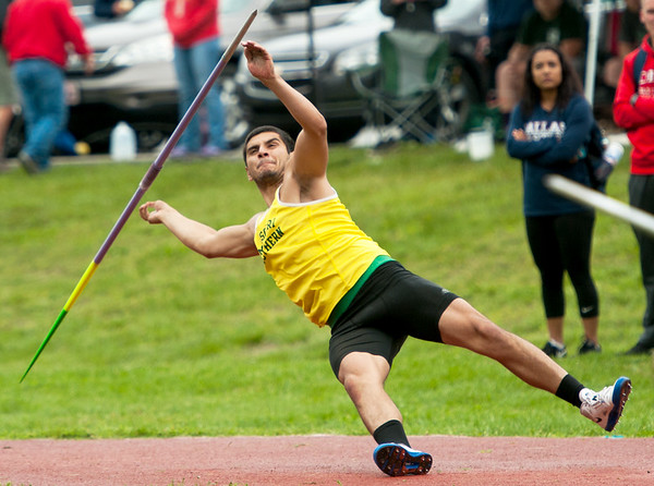 Missouri Southern's Daniel Hernandez slips on a wet runway during the during the Bill Williams/Bob Laptad Invitational on Friday at MSSU. Hernandez recovered to take first in the event.<br /> Globe | Laurie Sisk