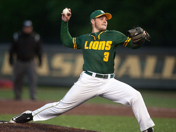 Missouri Southern's Colin Chandler throws with an 11-run lead during the Lions game against Pittsburg State on Wednesday night at Warren Turner Field.<br /> Globe | Laurie Sisk