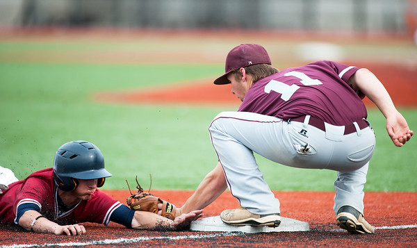 Joplin's Jake Yarnall gets tagged out on a steal attempt at third base by Rolla's Trey Sinnott during their game on Tuesday at JHS.<br /> Globe   Laurie Sisk
