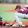Joplin's Jake Yarnall gets tagged out on a steal attempt at third base by Rolla's Trey Sinnott during their game on Tuesday at JHS.<br /> Globe | Laurie Sisk
