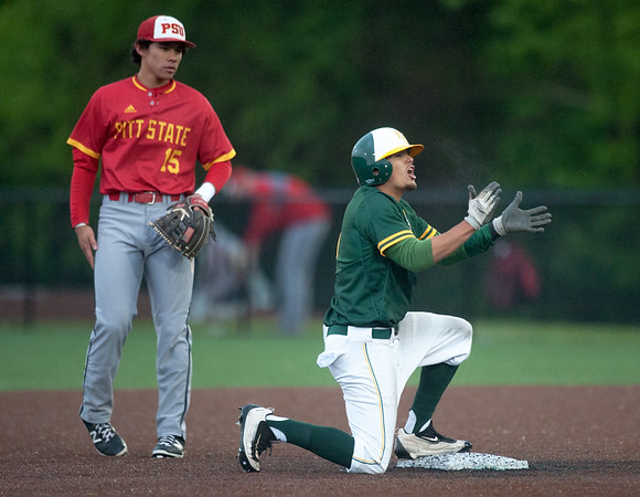 Missouri Southern's Alec Alvarez celebrates an RBI double as Pittsburg State second baseman Dallas Reed looks on  during their game against on Wednesday night at Warren Turner Field. The two-run hit broke open an 11-run third inning for the Lions.<br /> Globe | Laurie Sisk