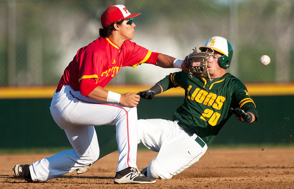 Pittsburg State second baseman Dallas Reed prepares to tag out Missouri Southern's Cory Canterbury during their game on Tuesday night at PSU.<br /> Globe | Laurie Sisk