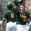 Missouri Southern centerfielder Cory Canterbury (20) is congratulated by teammate Mike Nillion (4) after hitting a solo homerun during the Lions' game against Central Missouri on Saturday at Warren Turner Field.<br /> Globe | Laurie Sisk