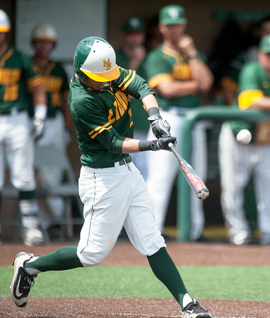 Missouri Southern centerfielder Cory Canterbury drives a pitch for a solo homerun during the Lions' game against Central Missouri on Saturday afternoon at Warren Turner Field.<br /> Globe | Laurie Sisk