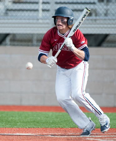 Joplin's Grant Jones lays down a successful sacrifice bunt during the Eagles' game against Rolla on Tuesday at JHS.<br /> Globe | Laurie Sisk