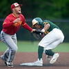 Pittsburg State shortstop Colton Pogue watches an errant throw as Missouri Southern's Mike Million steals second and third bases respectively during their game on Wednesday night at Warren Turner Field.<br /> Globe | Laurie Sisk