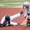 Neosho's Mason Ray eludes the tag of Sequoyah second baseman Skylar Birdtail Neosho's Jared Stephens connects for a lead-off double during their game on Friday morning at Joe Becker.<br /> Globe | Laurie Sisk