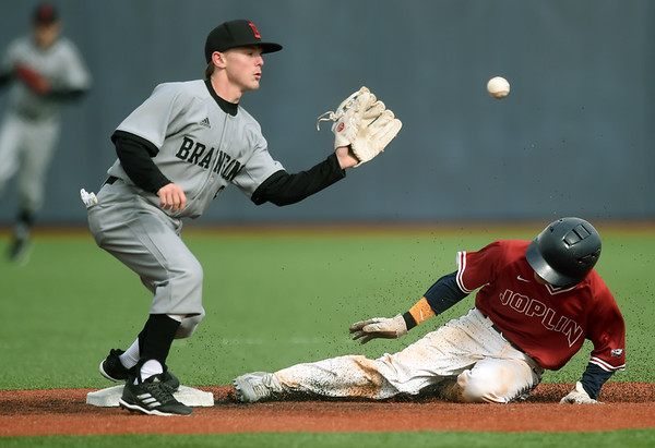 Joplin's Luke Benfield slides safely into second base for the steal as Branson's Skyler Harris fields the throw during their game on Tuesday at JHS.<br /> Globe | Laurie SIsk
