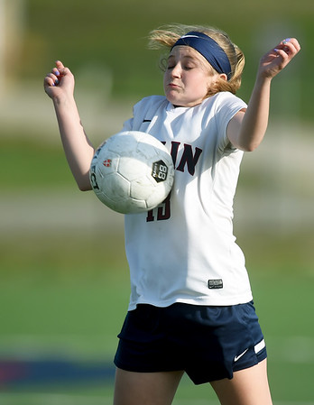 Joplin defender Annabelle Erisman bumps the ball after a kick during the Eagles' match against Central on Thursday at JHS.<br /> Globe | Laurie Sisk
