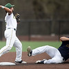 Missouri Southern second baseman Easton Fortuna throws to first base after getting the force out on Central Oklahoma's Bryant Klusener during their game on Tuesday night at Warren Turner Field.<br /> Globe | Laurie Sisk
