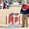 Longtime track official Oscar Birk helps clear hurdles during a track meet last Thursday at Northeast in Arma. Birk has interacted with an estimated 250,000 athletes during his 37-year career.<br /> Globe | Laurie Sisk