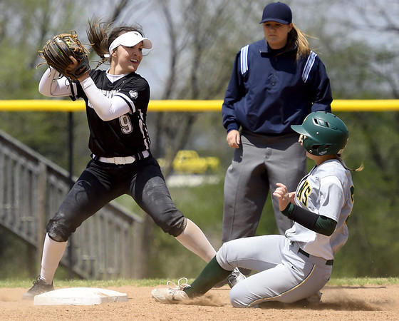 Missouri Southern second baseman Lexi Ferrari slides into the front end of a double play as Lindenwood's Megan Clark prepares to throw to first base during their game on Wednesday at Pat Lipiri Field.<br /> Globe   Laurie Sisk