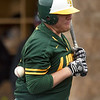 Missouri Southern's Alex Phillips grimaces after taking a pitch to the back during the Lions' game against Southwest Baptist on Saturday at Warren Turner Field.<br /> Globe | Laurie Sisk