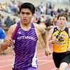 Pittsburg's Carlos Salas runs the third leg of the boys 4x800m relay as Raymore-Peculiar's Carson Eve closes in during the 29th Annual Jock's Nitch PSU Gorilla Relays on Friday at Carnie Smith Stadium.<br /> Globe | Laurie Sisk