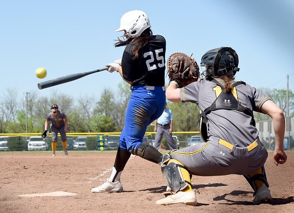 Crowder's Eila Infante makes contact with the ball as Three Rivers catcher Grace King awaits the pitch during their NJCAA Region XVI playoff game on Saturday at the Joplin Athletic Complex.<br /> Globe | Laurie Sisk