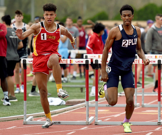 From the left: Columbus hurdler Kale Smith and Joplin's Grant Guillory compete in the 110 hurdles during the 29th Annual Jock's Nitch PSU Gorilla Relays on Friday at Carnie Smith Stadium.<br /> Globe   Laurie Sisk