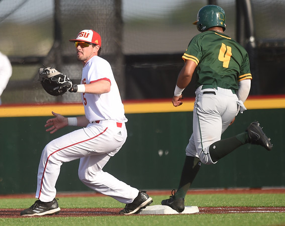 Pittsburg State first baseman xx gets the out on Missouri Southern's Mike Million during their game on Tuesday at PSU.<br /> Globe   Laurie Sisk