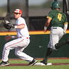 Pittsburg State first baseman xx gets the out on Missouri Southern's Mike Million during their game on Tuesday at PSU.<br /> Globe | Laurie Sisk