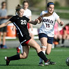 Joplin midfielder Ashley Bebee (15) and Central's Kourtney Tucker (20) vie for the ball during their match on Thursday at JHS.<br /> Globe | Laurie Sisk