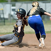 Crowder's Kenzie Kallio gets the tag on Three Rivers' Sophie Wunderlich during their NJCAA Region XVI playoff game on Saturday at the Joplin Athletic Complex. <br /> Globe | Laurie Sisk