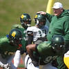 Missouri Southern Head Coach Denver Johnson visits with his players during the Lions' last practice of the Spring on Friday at Fred G. Hughes Stadium.<br /> Globe | Laurie Sisk