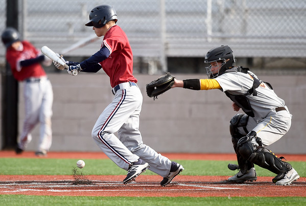 Joplin's Blake Dean tries to advance the runner on third base with a bunt as Kickapoo's Ivan Quackenbush mans the plate during their game on Wednesday at JHS.<br /> Globe | Laurie Sisk
