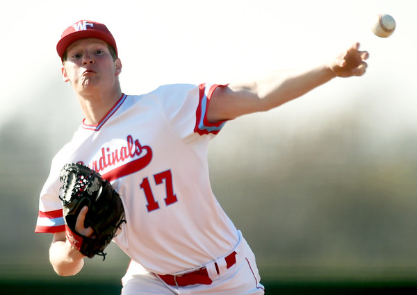 Webb City's Tyler Martin delivers a pitch to the plate during the Cardinal's game against Ozark on Tuesday at Webb City.<br /> Globe   Laurie Sisk