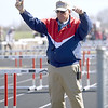 Longtime track official Oscar Birk readies junior high school athletes for the start of a race during a track meet last Thursday at Northeast in Arma. Birk has interacted with an estimated 250,000 athletes during his 37-year career.<br /> Globe | Laurie Sisk
