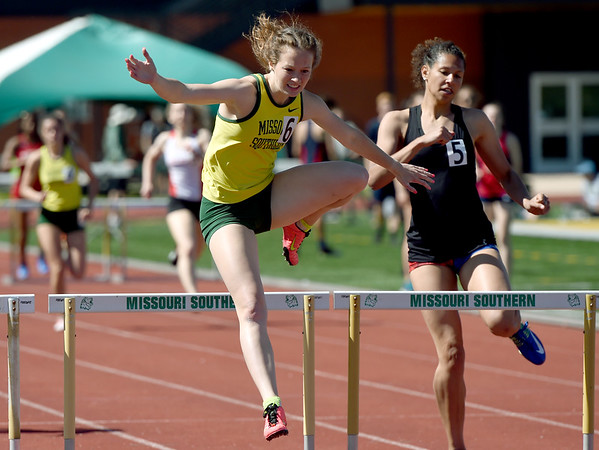 Missouri Southern's Rachel Ray races to a first place finish in the Women's 300m hurdles during the Bill Williams/Bob Laptad Invitational on Friday at Fred G. Hughes Stadium. Also pictured, right, is unattached hurdler Morgan Smith.<br /> Globe | Laurie Sisk