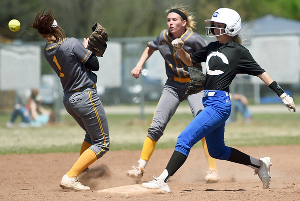Crowder's Kenzie Kallio reaches second base courtesy of a Three Rivers error during their NJCAA Region XVI playoff game on Saturday at the Joplin Athletic Complex. Also pictured, from the left: Three Rivers shortstop Kristyn Carpenter and rightfielder Sophie Wunderlich. <br /> Globe   Laurie Sisk