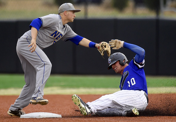 Crowder's Drew Reilly slides safely into second base as Northeastern Oklahoma's Troy Gagan fields the throw during their game on Tuesday night at Joe Becker.<br /> Globe | Laurie Sisk