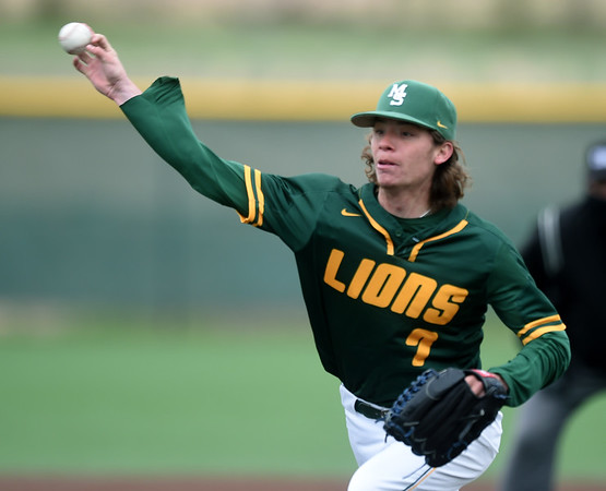 Missouri Southern's Jared Flores delivers a pitch to the plate during the Lions' game against Southwest Baptist on Saturday at Warren Turner Field.<br /> Globe   Laurie Sisk
