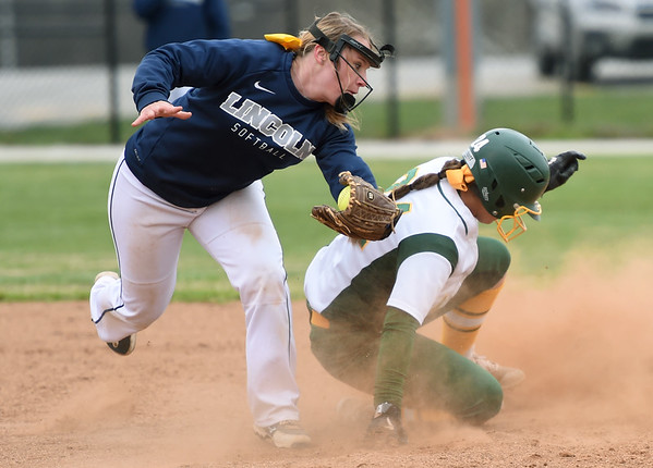 Missouri Southern's Ashley Caldarella (24) slides safely into second base as Lincoln's Rachael Balke fields the throw during their game on Saturday at MSSU.<br /> Globe   Laurie Sisk
