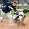 Missouri Southern's Ashley Caldarella (24) slides safely into second base as Lincoln's Rachael Balke fields the throw during their game on Saturday at MSSU.<br /> Globe | Laurie Sisk