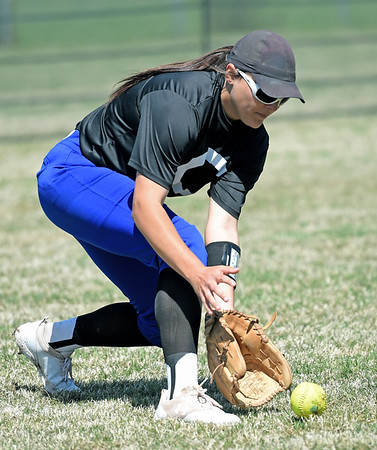 Crowder leftfielder Daryan Torix scoops up a ball during the Roughriders opening game of the Region XVI NJCAA Championship against State Fair on Friday morning at the Joplin Athletic Complex.<br /> Globe   Laurie Sisk