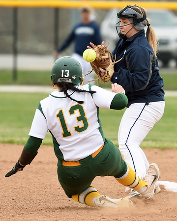 Missouri Southern's Erika Lutgen slides safely into second base as Lincoln's Rachael Balke tries to handle the throw during their game on Saturday at MSSU.<br /> Globe   Laurie Sisk
