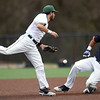 Missouri Southern second baseman Easton Fortuna can't catch up to an errant throw as Central Oklahoma's Xavier Freeman slides into second base during their game on Tuesday night at Warren Turner Field.<br /> Globe | Laurie Sisk