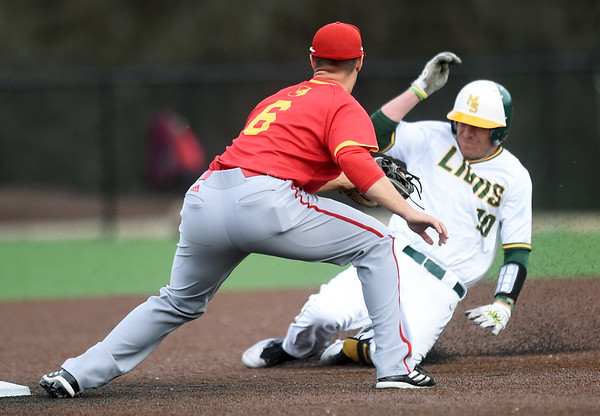 Missouri Southern's Denver Coffee evades the tag of as Pittsburg State shortstop Colton Pogue during their game on Wednesday night at Warren Turner Field.<br /> Globe | Laurie Sisk